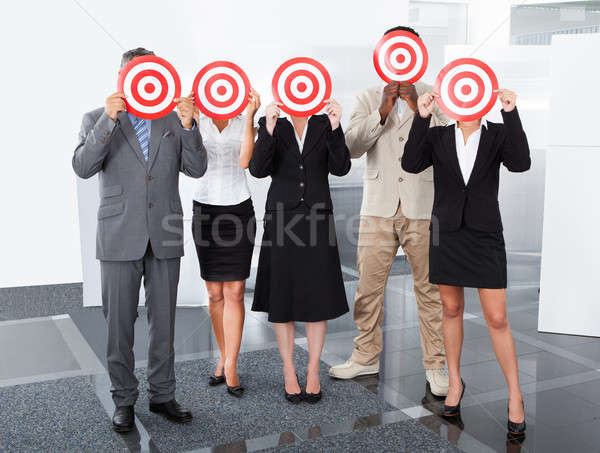 Businesspeople Holding Dartboard Stock photo © AndreyPopov
