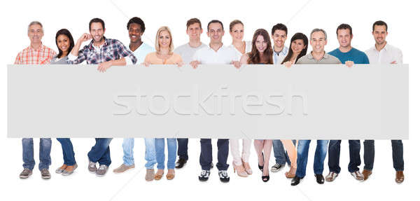 Group of business people with a blank banner Stock photo © AndreyPopov