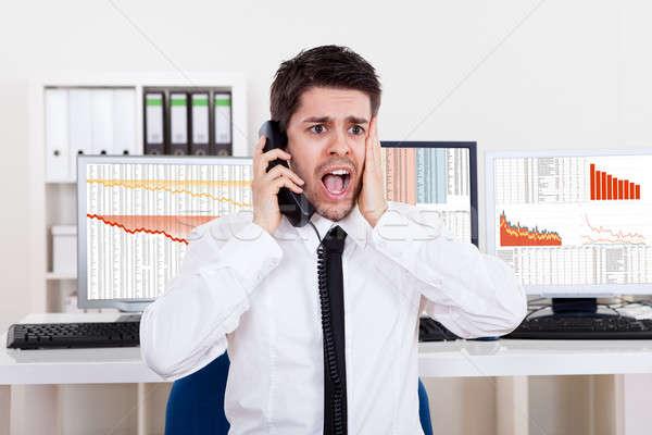 Worried stock broker on the phone Stock photo © AndreyPopov