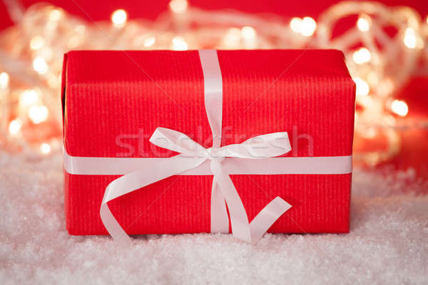 Red Gift Box Tied With White Ribbon Stock photo © AndreyPopov