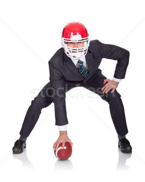 Competitivo empresário jogar americano futebol isolado Foto stock © AndreyPopov
