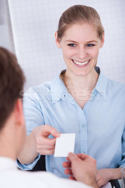 Happy Businesswoman Exchanging Visiting Card Stock photo © AndreyPopov