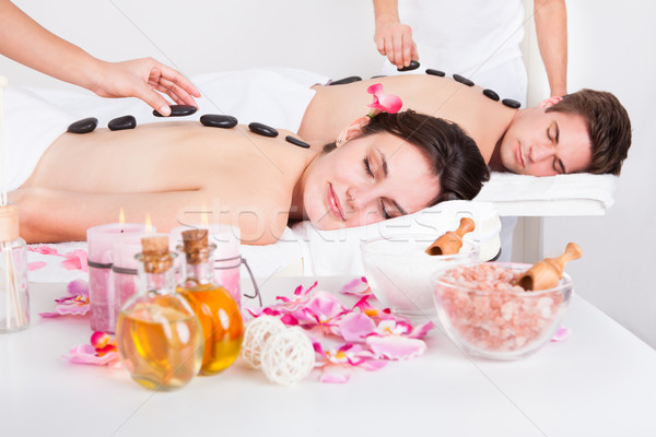 Couple pierre massage belle spa Photo stock © AndreyPopov