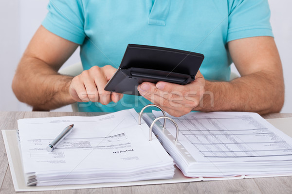 Man Calculating Financial Expenses Stock photo © AndreyPopov