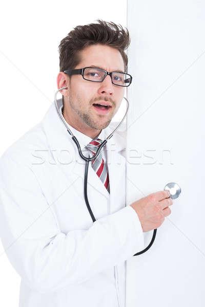 Stock photo: Doctor Examining Billboard With Stethoscope