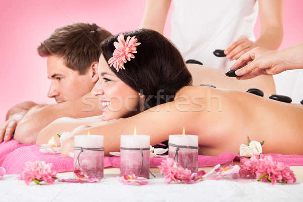 Couple Receiving Massage With Herbal Compress Stamps At Spa Stock photo © AndreyPopov