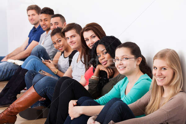 Confident University Students Sitting In A Row Stock photo © AndreyPopov