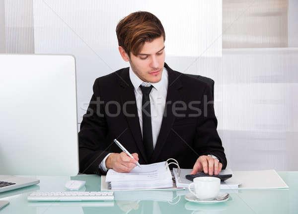 Businessman Using Calculator Stock photo © AndreyPopov