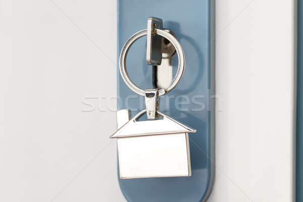 Finger Inserting Key In Keyhole Stock photo © AndreyPopov