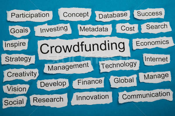 Word Crowdfunding On Piece Of Torn Paper Stock photo © AndreyPopov