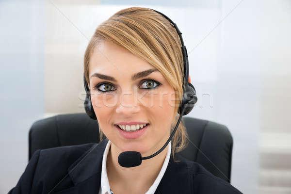 Sorridente feminino atendimento ao cliente representante microfone Foto stock © AndreyPopov