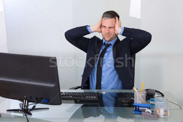 Businessman Suffering From Headache Stock photo © AndreyPopov