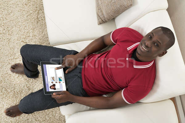 Man Surfing On Social Networking Website Stock photo © AndreyPopov