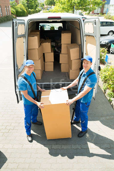 Two Movers Loading Boxes In Truck Stock photo © AndreyPopov