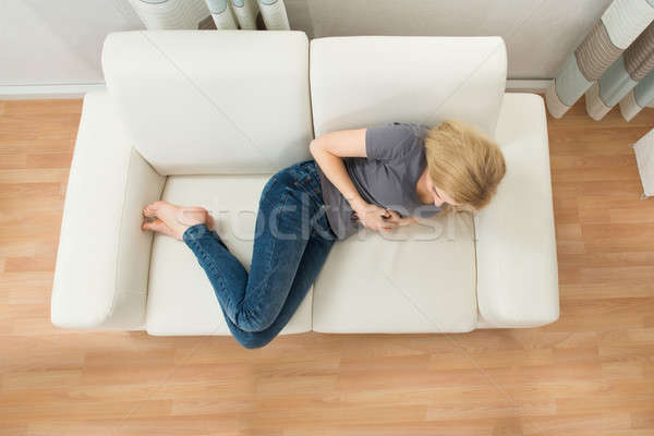 Woman Suffering From Stomachache Stock photo © AndreyPopov