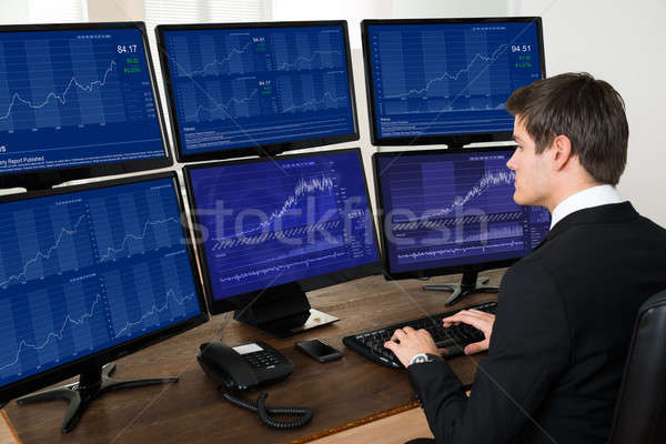 Businessman Working With Graphs On Computers Stock photo © AndreyPopov