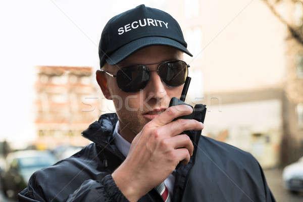 Güvenlik görevlisi konuşma portre genç erkek teknoloji Stok fotoğraf © AndreyPopov