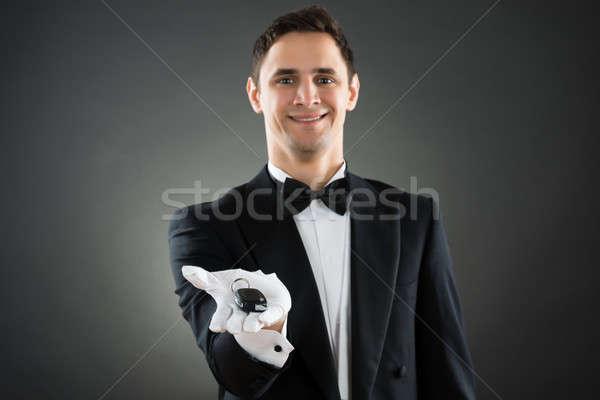 Portrait Of Happy Waiter Giving Car Keys Stock photo © AndreyPopov