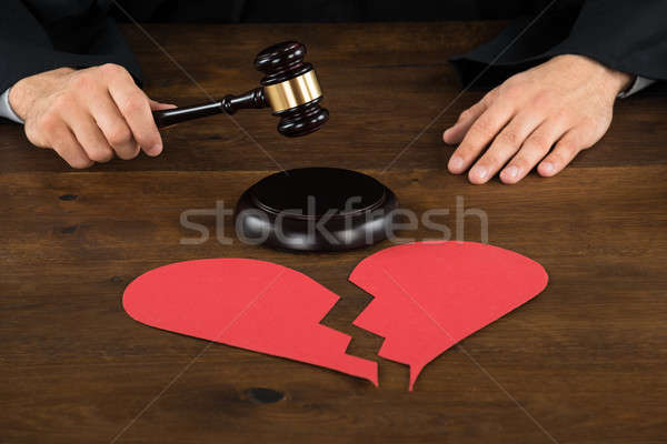 Divorce Lawyer With Broken Heart Hitting Gavel Stock photo © AndreyPopov