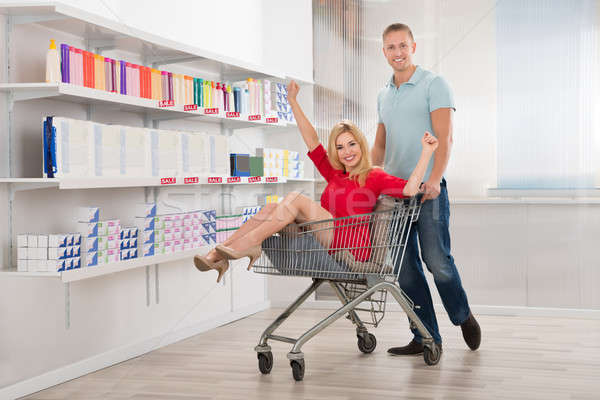 Happy Man Cheering With Woman Sitting In Shopping Cart Stock photo © AndreyPopov