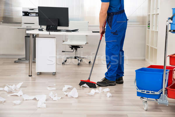 Janitor Sweeping Floor With Broom In Office Stock photo © AndreyPopov