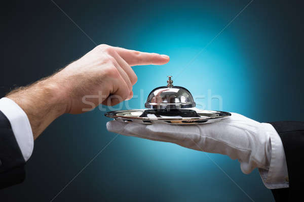 Businessman Ringing In Service Bell Held By Bellboy Stock photo © AndreyPopov