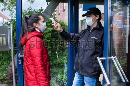 Hooded Man Using Crowbar To Open Glass Door Stock photo © AndreyPopov