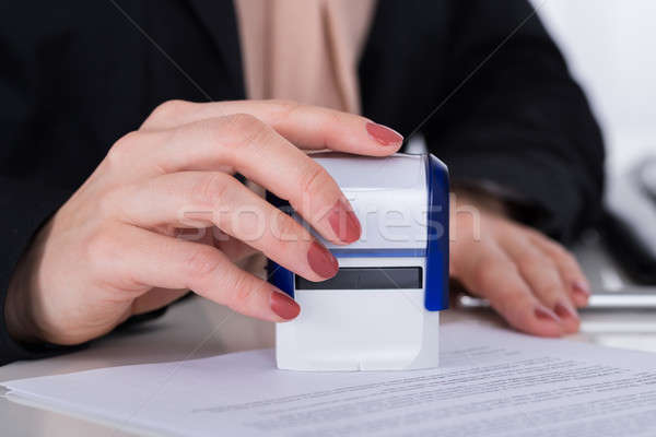 Businessperson Using Stamper On Document Stock photo © AndreyPopov