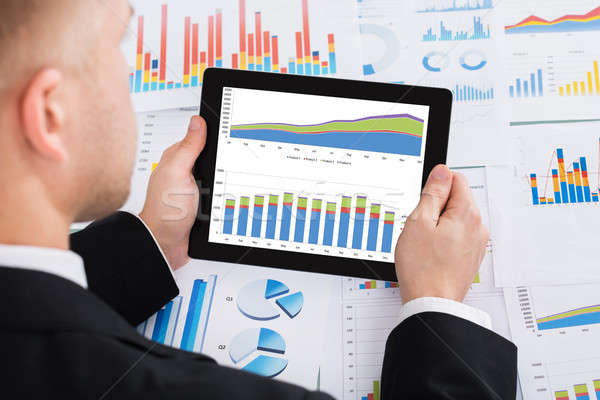 Stock photo: Businessperson Analyzing Graph On Digital Tablet