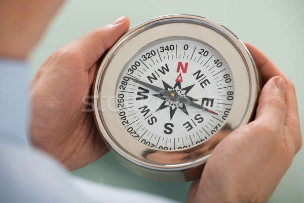 Person Hand With Compass Stock photo © AndreyPopov