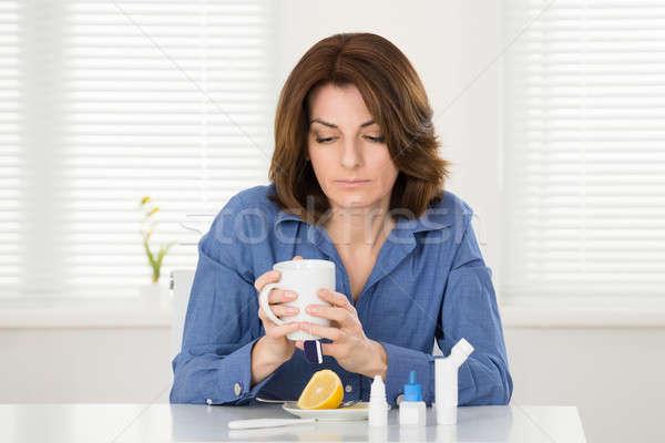 Sick Woman Drinking Lemon Tea Stock photo © AndreyPopov