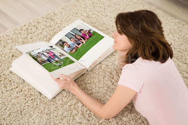 Woman Looking At Family Photo Album Stock photo © AndreyPopov