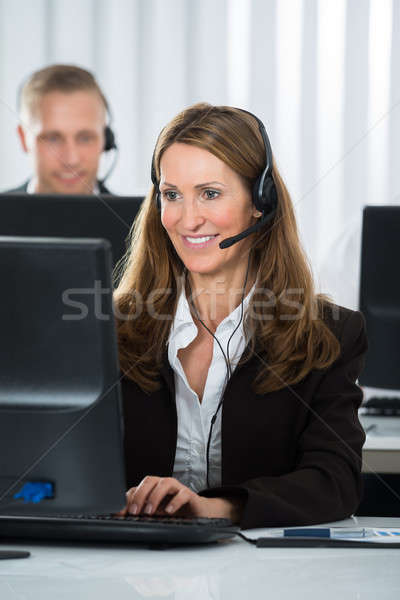 Call Center Executive Working In Office Stock photo © AndreyPopov
