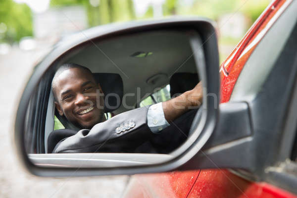 Stock photo: Reflection Of Businessman Sitting In Car