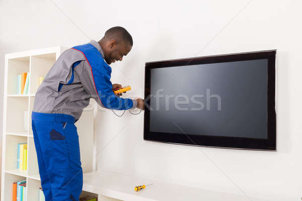 Electrician Checking Television With Multimeter Stock photo © AndreyPopov