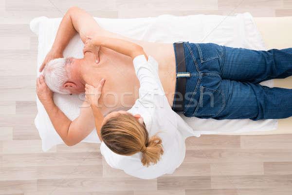 Feminino terapeuta massagem senior homem Foto stock © AndreyPopov