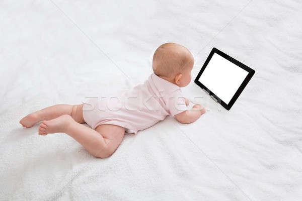 Bebek bakıyor dijital tablet mutlu bilgisayar Stok fotoğraf © AndreyPopov