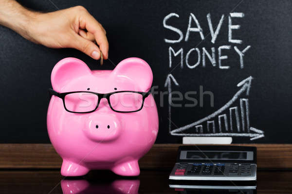 The Save Money Concept In Front Of Blackboard Stock photo © AndreyPopov