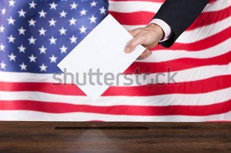 Stemmen vak Amerikaanse vlag hand Stockfoto © AndreyPopov