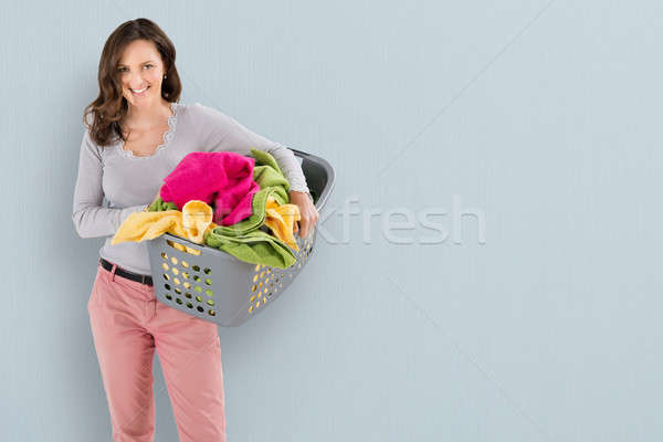 Woman Carrying Laundry Basket Stock photo © AndreyPopov