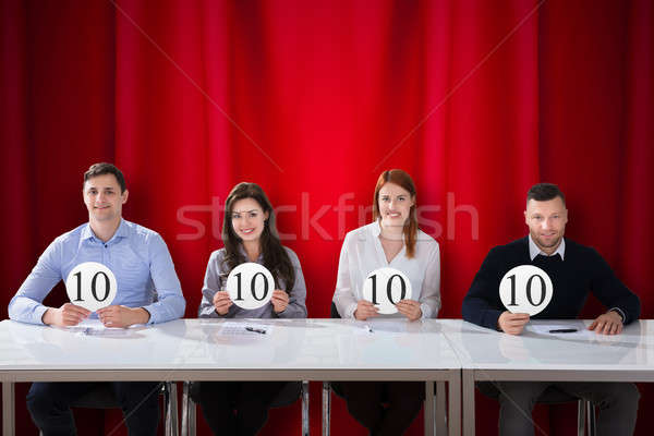Stock photo: Panel Judges Holding 10 Score Signs