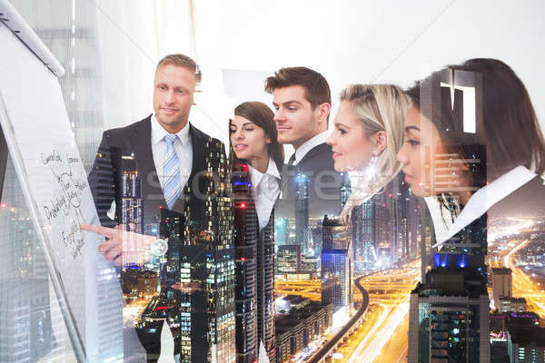 Business People Cover Illuminated Cityscape Background Stock photo © AndreyPopov