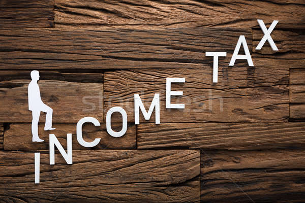 Paper Businessman Climbing Income Ladder On Wood Stock photo © AndreyPopov