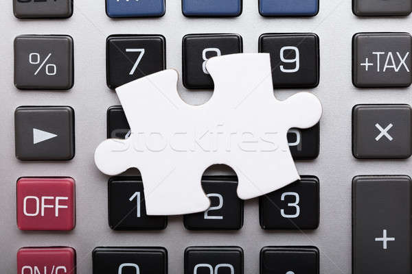 Blank Jigsaw Puzzle Piece On Calculator Stock photo © AndreyPopov