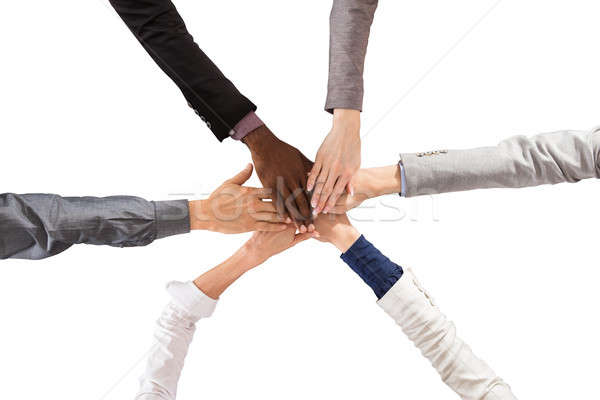 Multi Ethnic People Stacking Hands Stock photo © AndreyPopov