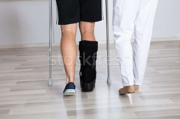 Low Section View Of Physiotherapist And Injured Person's Leg Stock photo © AndreyPopov