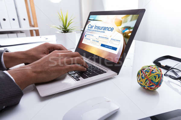 Businessperson Filling Car Insurance Form On Laptop Stock photo © AndreyPopov