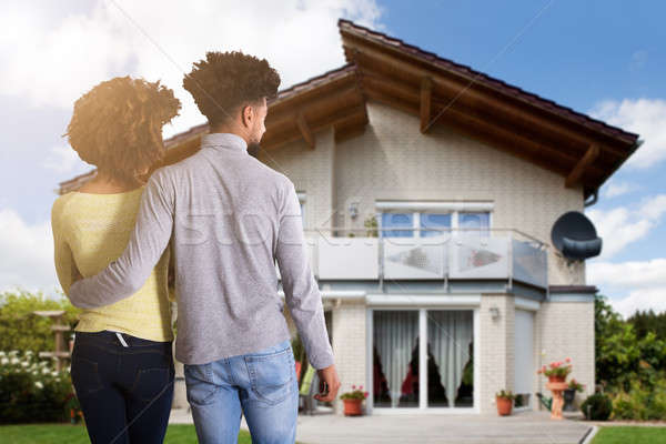 Couple Standing In Front Of House Stock photo © AndreyPopov
