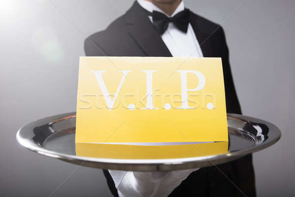Waiter Showing Vip Text On Banner Stock photo © AndreyPopov
