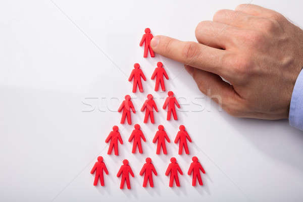 Red Human Figures Arranged In Triangular Shape Stock photo © AndreyPopov